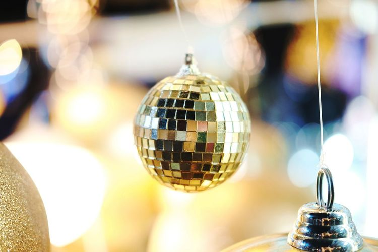 Beautiful lighting and Gold balls decorated hanging on White Christmas Trees Celebration with Bokeh blurred, fairy and sparkling background.Copy space Disco Ball Celebration Nightlife Nightclub Sphere Shiny Event Indoors  Party - Social Event Night Illuminated Focus On Foreground Close-up Decoration No People Hanging Reflection Arts Culture And Entertainment Selective Focus Disco Dancing Dance Floor Entertainment Club