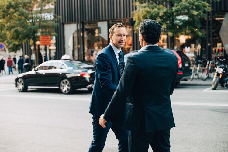 Men on street in city