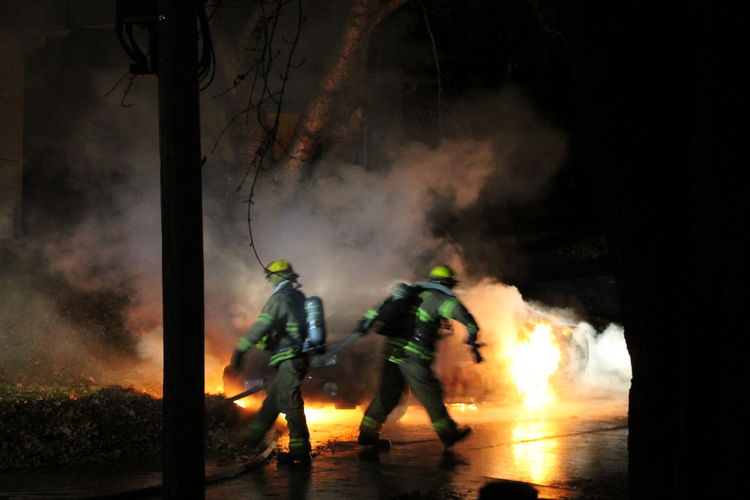 Firefighters at work during night
