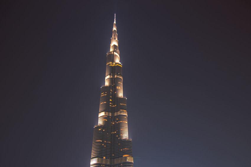 Architecture Burj Khalifa City Dubai DXB Gold Colored Illuminated Night No People Outdoors Sky Skyscraper Tower Travel Destinations