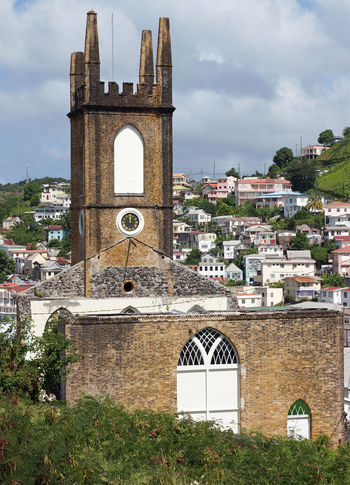 Steeple of the Presbyterian Church of Saint Georges. The church was destroyed during the hurican Ivan. Grenada, Caribbean. Antilles Architecture Building Exterior Built Structure Caribbean Church Church Tower City Day Grenada Hurican Leeward Islands No People Outdoors Place Of Worship Ruin Ruined Building Saint Georges Steeple Tourism Tourist Attraction  Town Travel Travel Destinations West Indies
