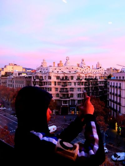 Morning photographer Architecture Built Structure Building Exterior Sky Rear View City Photographer Mobilephotography Dawn Dawn Of A New Day Barcelona Gaudi Gaudì Architecture Work Casa Mila ( La Pedrera ) Cityscape Lifestyles