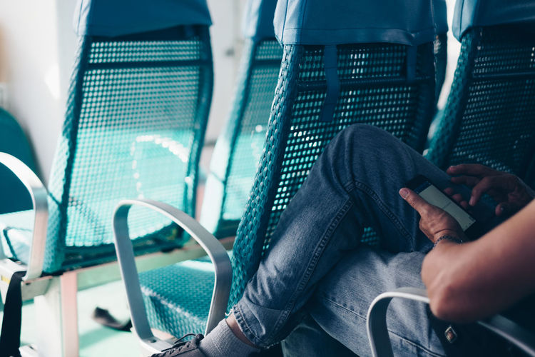 Midsection of man sitting in bus