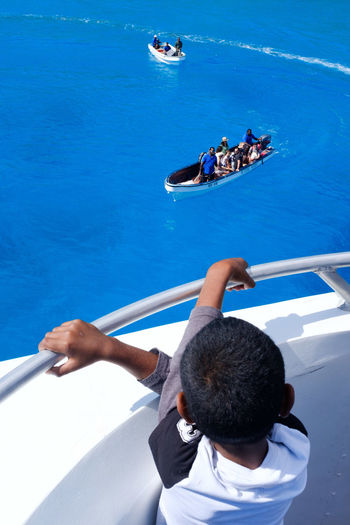 Streetphotography Street Photography Back Child Boy Boat Fiji Fiji Islands South Pacific Pacific Ocean Water One Person High Angle View People Outdoors Day Vacations Leisure Activity Summer Sea