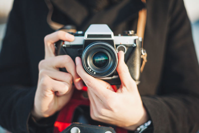 Photographer taking photo with film camera Camera Man Retro Camera Camera - Photographic Equipment Close-up Film Camera Front View Hand Hipster Holding Human Hand Leisure Activity Lens - Optical Instrument Male Midsection One Person Photographer Photographic Equipment Photographing Photography Themes Real People Vintage