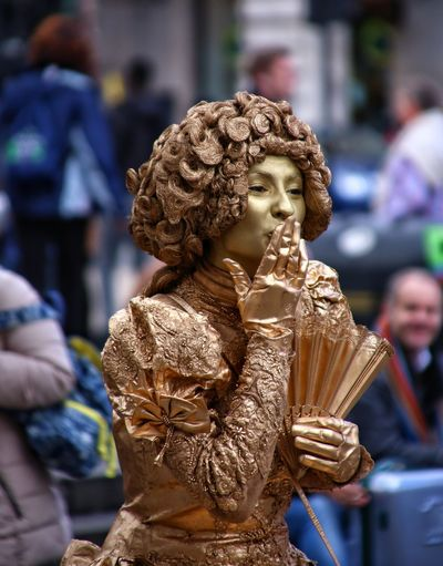 Young Woman In Costume Blowing Kiss