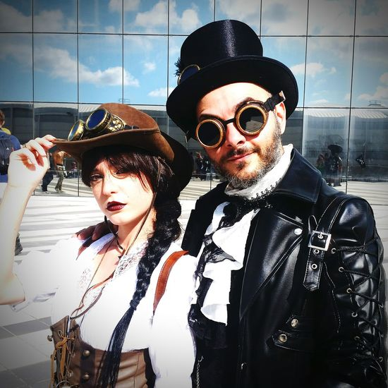 Portrait of couple in costume standing outdoors