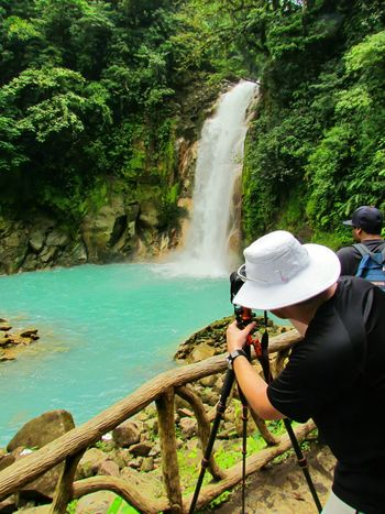 People And Places Water Tree Leisure Activity Side View Lifestyles Togetherness Nature Day Outdoors Person Green Color Tranquil Scene Summer Photographer Photography Work Lush Foliage Tranquility Waterfall Rio Celeste Costarica Costa Rica Blue Blue Water