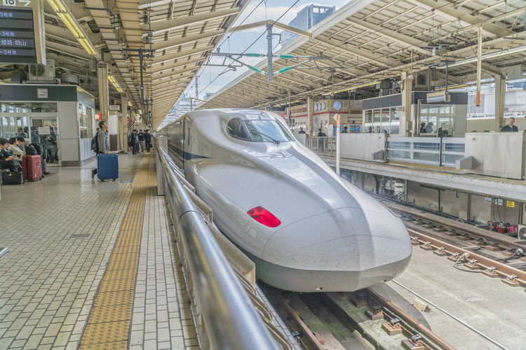 Japanese Shinkansen Transportation Mode Of Transportation Public Transportation Rail Transportation Architecture Travel Incidental People Train Built Structure Indoors  Railroad Station Railroad Station Platform Real People Train - Vehicle Group Of People Land Vehicle Men Lifestyles Track Day Subway Train