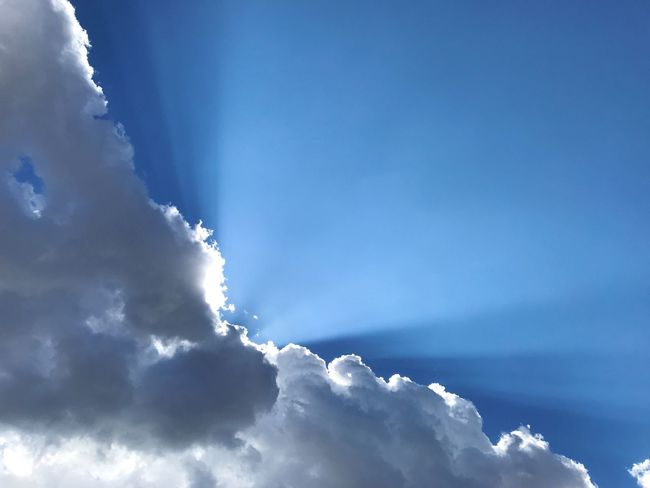 """""""Shining Light"""" A stunning cloud formation with the sun beaming out like a searchlight in the skies of Central New Mexico. Dramatic Sky Clouds And Sky New Mexico New Mexico Photography New Mexico Skies Sunbeam Sunlight Sky Cloud - Sky Blue Scenics - Nature Nature"""