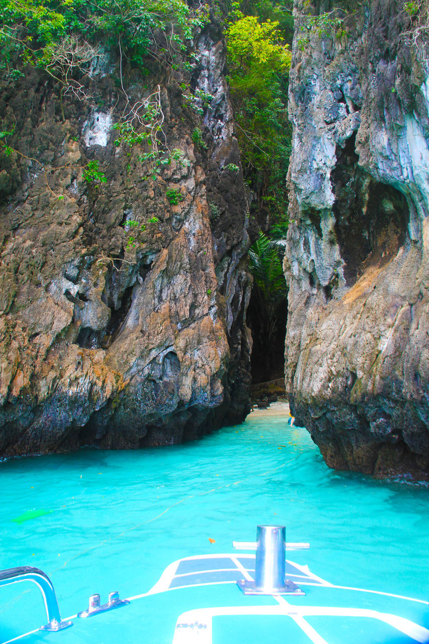 water, rock - object, rock formation, sea, nature, scenics, beauty in nature, swimming pool, cliff, no people, tranquility, day, outdoors, vacations, nautical vessel, mountain, longtail boat