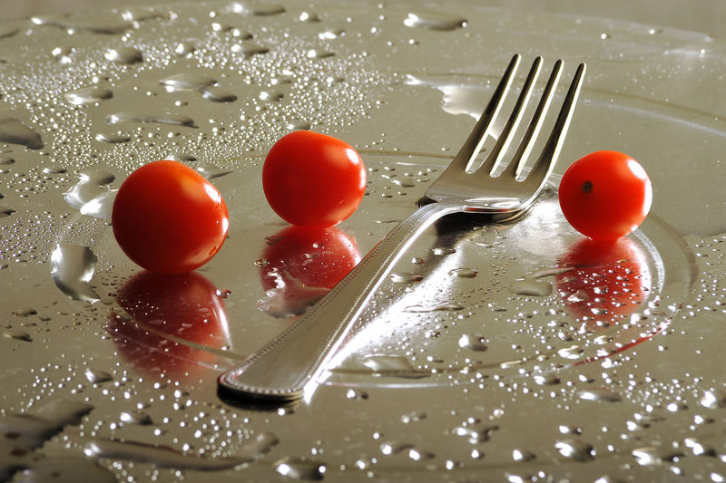 Close-up of tomatoes in plate on table