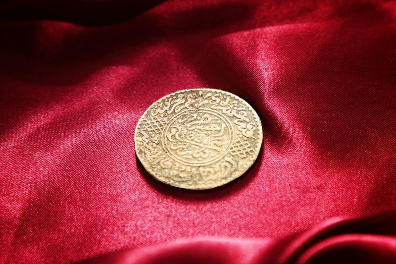 old islamic coin Islamic Culture Morocco Coins Gold Coins Artisanat Coincollector Collections Wallpaper Canonphotography Canon5dmarkiii Coincollection EyeEm Selects Cooper Coin Textile Currency Gold Colored Wealth Studio Shot History Circle Red Close-up Civilization Ancient Civilization Ancient History The Past Ancient