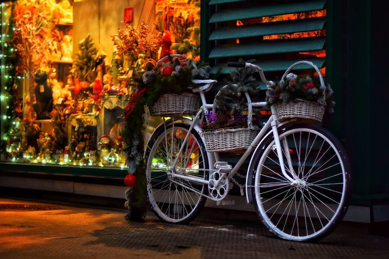 Transportation Land Vehicle Bicycle Mode Of Transportation Architecture Built Structure City Wheel Flower Stationary Outdoors No People Plant Street Illuminated Night Flowering Plant Building Exterior Nature Decoration