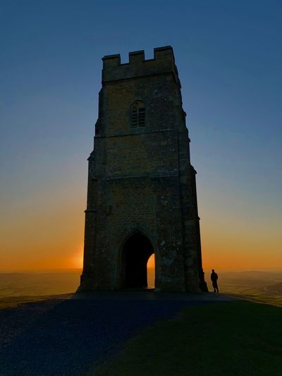 Architecture Beauty In Nature Built Structure Clear Sky Day Glastonbury Tor History Nature Outdoors Real People Silhouette Sky Sunset