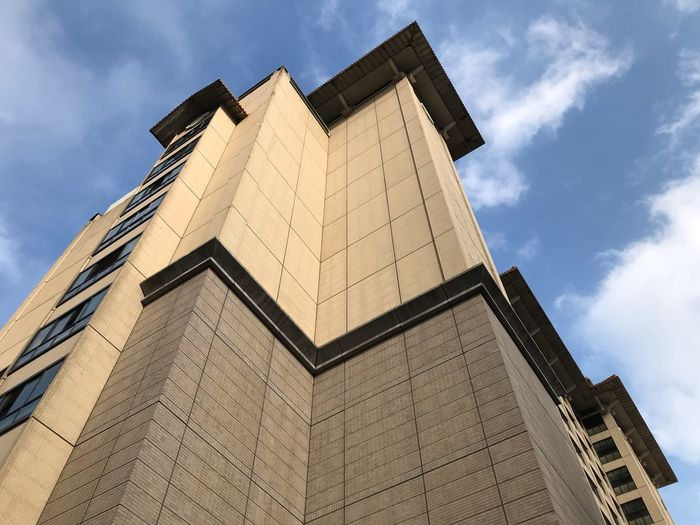 EyeEm Selects Architecture Built Structure Low Angle View Building Exterior Sky Building No People Day City Outdoors Tall - High Corner Office Building Exterior Modern Cloud - Sky