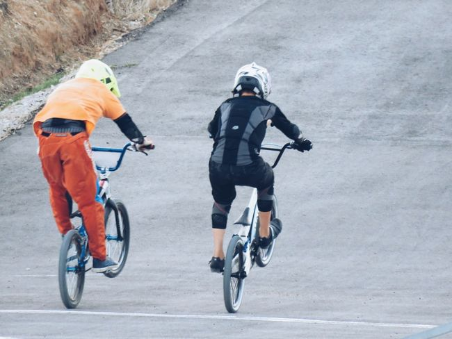 Bicycle Full Length Cycling Headwear Two People Togetherness Adult Adventure Day Riding Men People Road Outdoors Sport Sports Helmet Friendship Adults Only Only Men Sports Clothing Stunt Light And Shadow From My Point Of View Road Motion