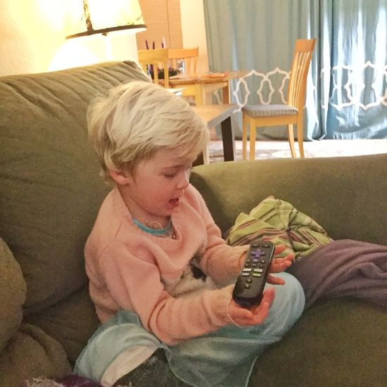 All hail the remote! Little Blond Girl