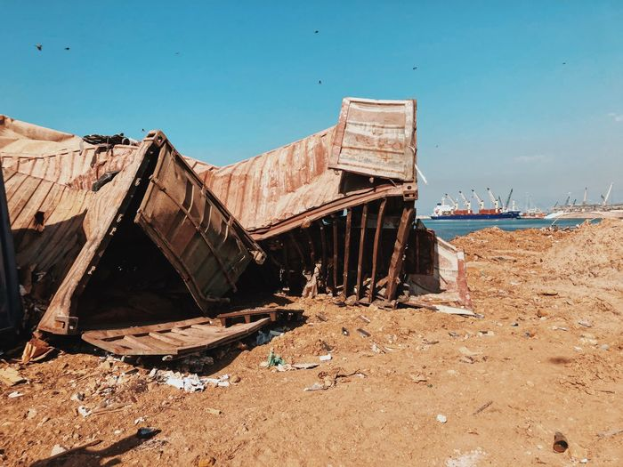 Abandoned shipping containers from the beorut explosion against clear sky