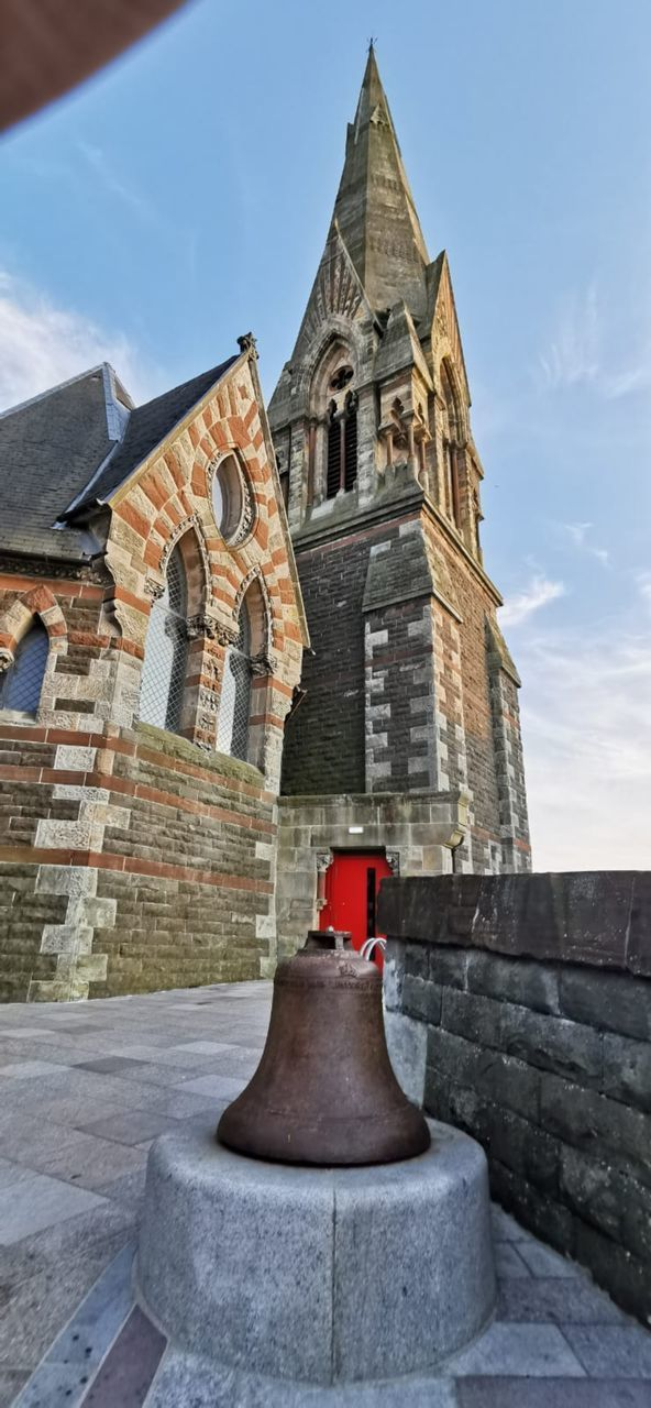 architecture, built structure, building exterior, religion, building, sky, belief, place of worship, tower, spirituality, day, history, the past, nature, low angle view, travel destinations, no people, outdoors, spire, stone wall