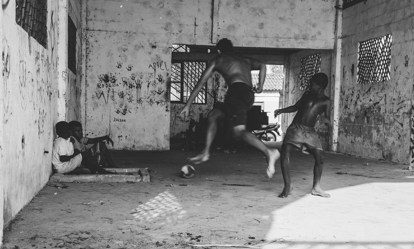 Men playing on wall