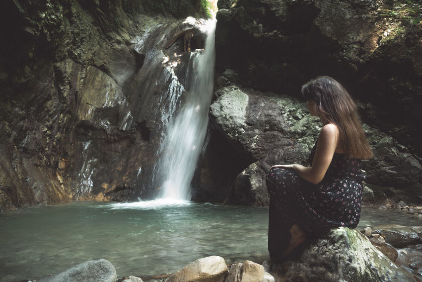 she Water Rock Waterfall Rock - Object Long Exposure Solid Flowing Water One Person Scenics - Nature Motion Beauty In Nature Leisure Activity Blurred Motion Rock Formation Nature Real People Lifestyles Young Adult Hair Outdoors Hairstyle Flowing Power In Nature