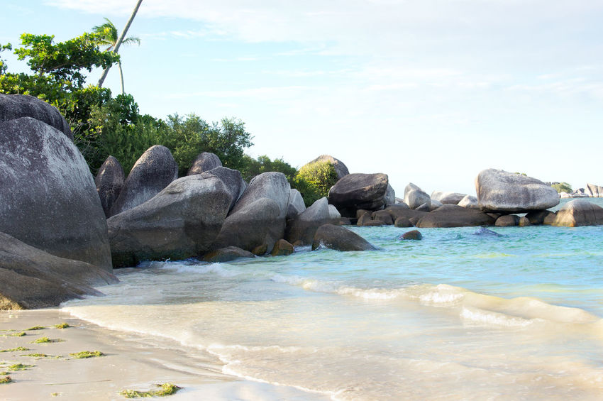 Natural rock formation in the sea and on a white sand beach in Belitung Island in the afternoon, Indonesia. Banka Beach Belitung Belitung Indonesia Belitung Island Coastline Landscape Daytime Granite Formations Granite Rocks Ocean Pristine Rocks And Water Rocks On The Shore Seaside Stones Sumatra  Summer Tanjung Tinggi Tranquil Scene Tranquility Travel Destinations Tropical Climate Vacation Destination White Sand Beach