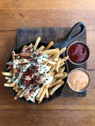 …and now for a delicious 'Stout Burger' along with so called Loaded Fries. Fries Food Food And Drink Freshness Table Ready-to-eat Still Life Wood - Material