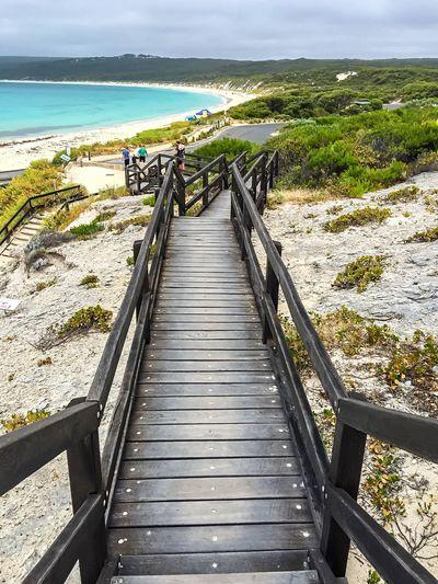 Boardwalk At Beach Against Sky