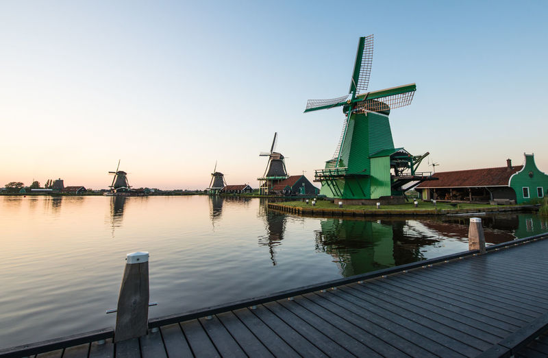 Zaanse schans, Holland - Traditional Dutch windmills with canal close Alternative Energy Commercial Dock Crane Crane - Construction Machinery Development Environmental Conservation Harbor Industry Mast Mode Of Transport Nature No People Outdoors Renewable Energy Ship Sky Water Wind Power Windmill
