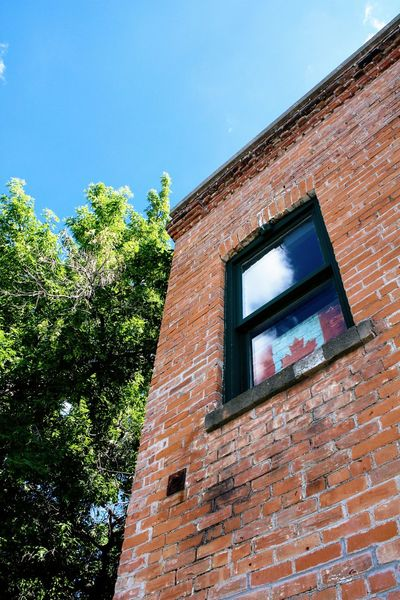 Window Building Exterior Low Angle View Architecture Sky Built Structure Canada Canada 150 Canada Flag Old Brick Brick Building Small Town Alberta History Historic Tree Outdoors