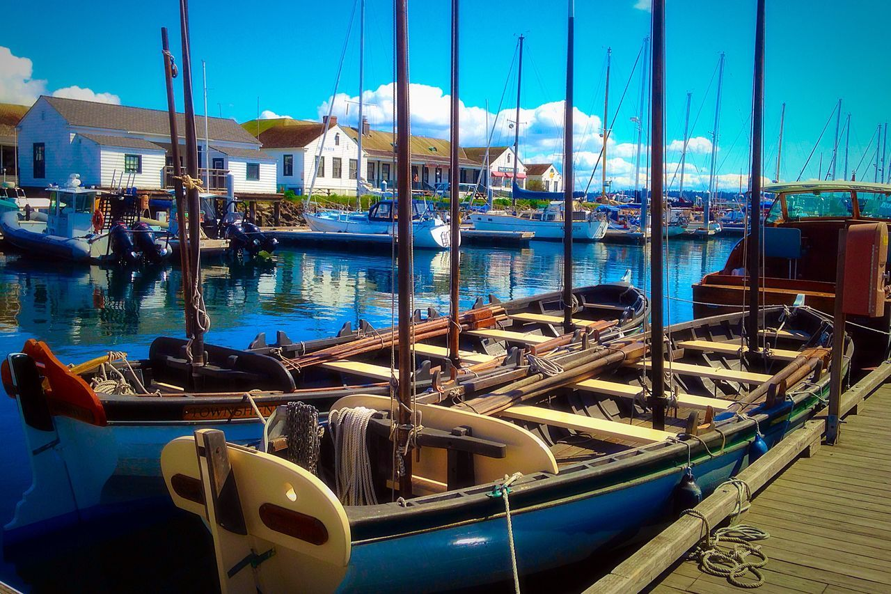 Moored Rowboats In Water
