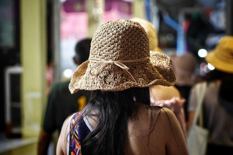 Rear view of woman wearing hat