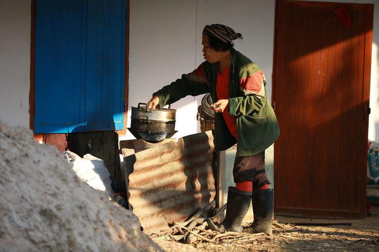 Woman preparing food in room