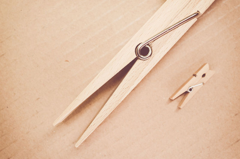 Directly above shot of wooden clothespins on table