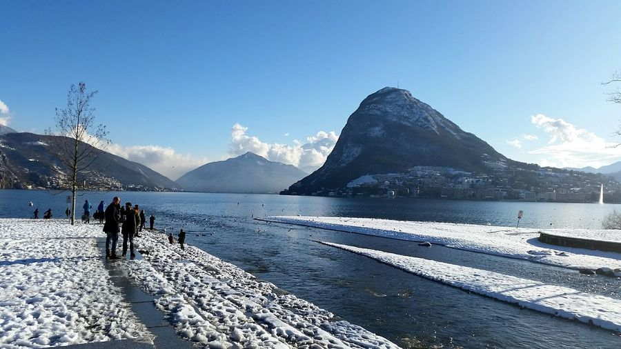 Lugano, Switzerland Lugano Lago Di Lugano  Lago Alpi Svizzera Alps Landscape Montains And Sun Daylight Day Winter Day Lake Snow River Winter San Salvatore Snowcapped Mountain Inverno Neve Giorno Fiume