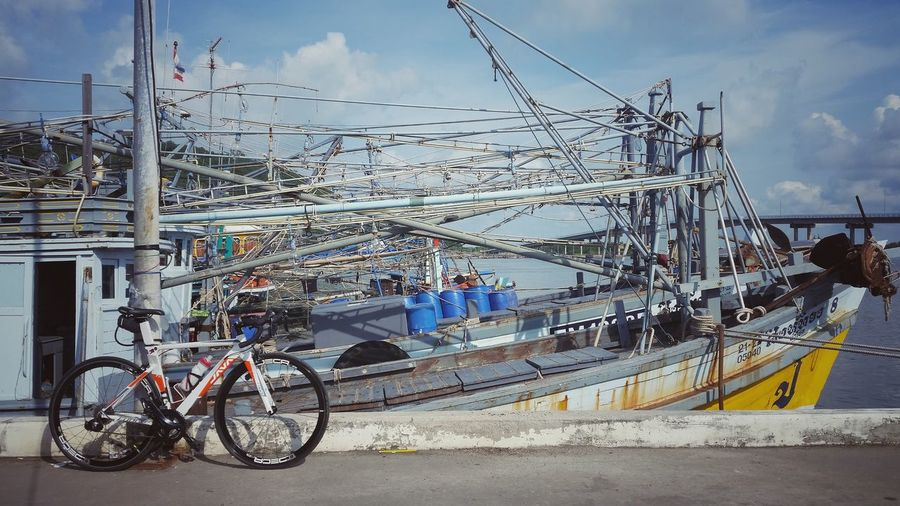 Bicycle Mode Of Transport Outdoors Cloud - Sky Sky Day Transportation No People Land Vehicle Cycling Trip  Cyclinglife Cycling Adventure Thailand🇹🇭 Ships In Port Fishing Village Roadbikes Roadbiketrip