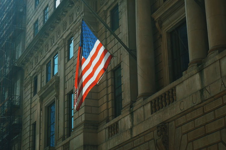Low Angle View Of American Flag On Building