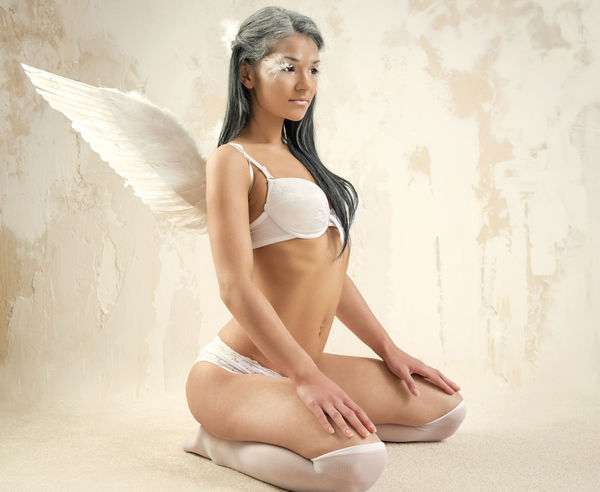 Young woman as angel with white wings over white obsolete wall Fairy Makeup Myth Sitting Wall Woman Angel Angel Wings Attractive Beautiful Woman Brunette Full Length Indoors  Lingerie Long Hair Model Mythology One Person Pose Real People Sexygirl Studio Shot Underwear😈 Young Adult Young Women