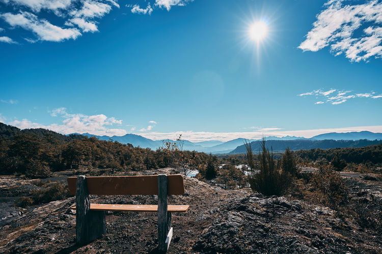 Infinity... EyeEmNewHere Beauty In Nature Bench Bright Cloud - Sky Day Environment Idyllic Landscape Mountain Mountain Range Nature No People Non-urban Scene Outdoors Park Bench Scenics - Nature Seat Sky Sun Sunlight Tranquil Scene Tranquility Travel Destinations Wood - Material