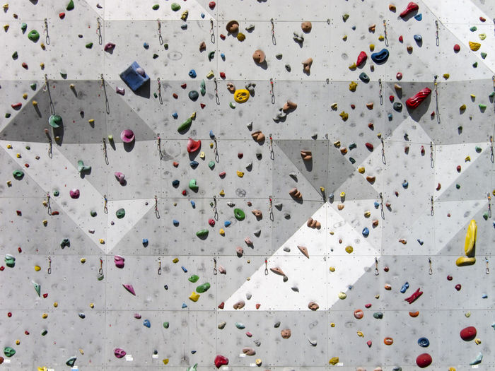 Adventure Challenge Climbing Climbing Wall Day Enjoyment Extreme Sports Full Frame Health Club Indoors  Leisure Activity Low Angle View Multi Colored No People Recreational Pursuit Rock Climbing Sport クライミング