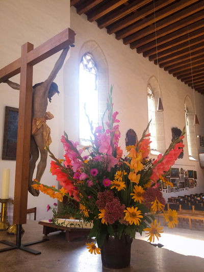 Altar Church Jesus Christ Spirituality Architecture Close-up Contre-jour Shot Crucifix Day Decorated Flower Flowers Indoors  No People Religion Statue Sunlight Vase Window