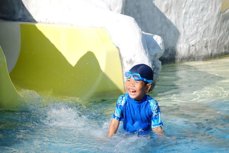 Cheerful boy enjoying in swimming pool
