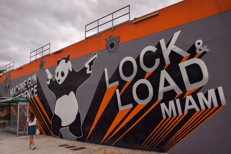 Lock and Load Miami, stand de tir ! Architecture Sky Built Structure Text Communication Building Exterior Day Graffiti Nature Outdoors Lifestyles Street Art City Men Wall - Building Feature Art And Craft Sign Cloud - Sky Creativity Real People First Eyeem Photo