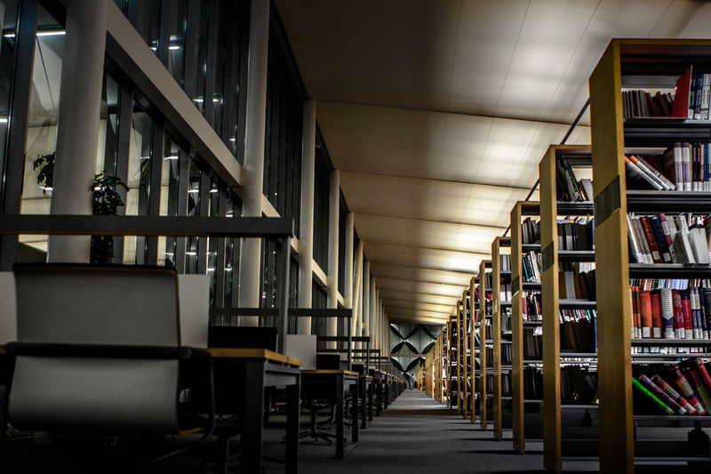The interior of King Fahad National Library (KFNL). KFNL is a public library in the heart of Saudi Arabia capital, Riyadh Achitecture Books Chairs And Tables In KFNL King Fahad National Library Know Knowledge Library Riyadh Shelves The Architect - 2016 EyeEm Awards