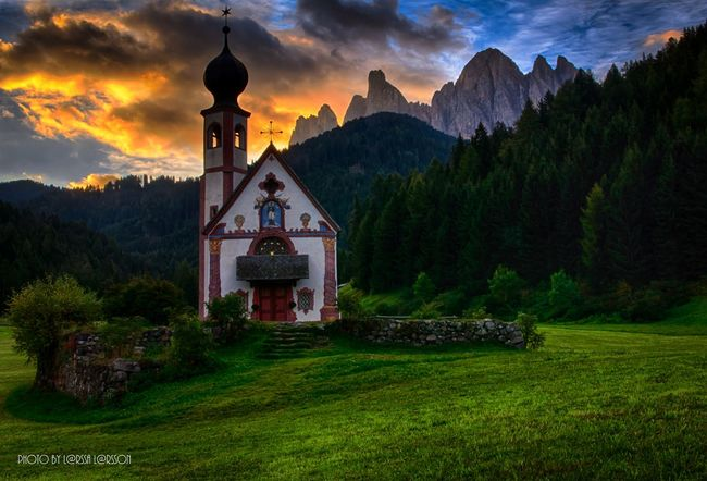 St John's Church, Val di Funes. Mountain Built Structure Architecture Building Exterior Tranquil Scene Scenics Tranquility Tower Mountain Range Remote Sky Outdoors Green Color Beauty In Nature Lens Flare Nature Cloud - Sky Mountain Peak Place Of Worship Non-urban Scene Landscape People And Places Beautiful