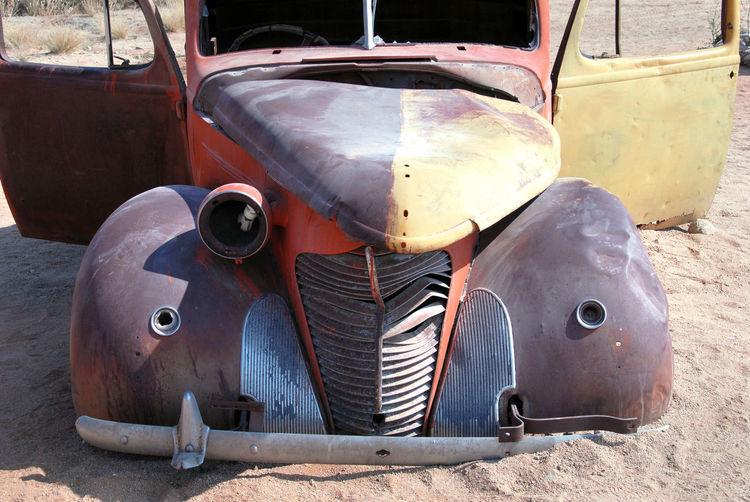 Close-up of abandoned vintage car