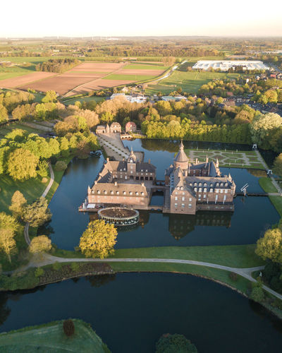 Wherever you go there is always something new to discover :) Found this hidden gem on a weekend trip to the Niederrhein. At 6am it had the perfect mirror reflection! Aerial View Anholt Architecture Birds Eye View Building Exterior Built Structure Castle Day Deutschland Dji DJI Mavic Pro Drone  Germany Nature No People Outdoors Sky Sunrise Travel Destinations Tree Wasserschloss Water
