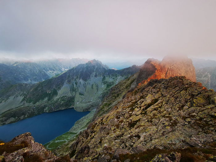 Cloudy mountain peaks at sunrise. tatry poland, rysy on the right.
