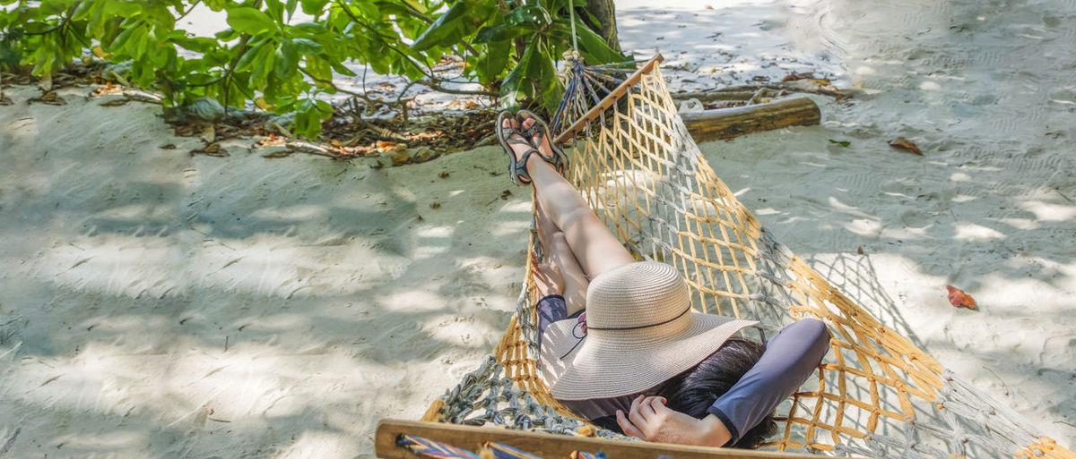 High angle view of woman sitting at riverbank